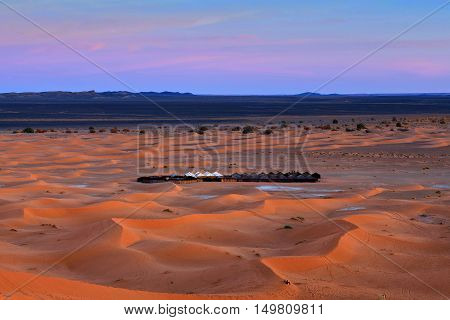 Sand dunes and tent camping in Erg Chebbi, Western Sahara, Morocco, North Africa