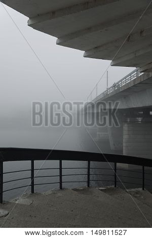 misty morning in Pskov the river and the bridge shrouded in fog