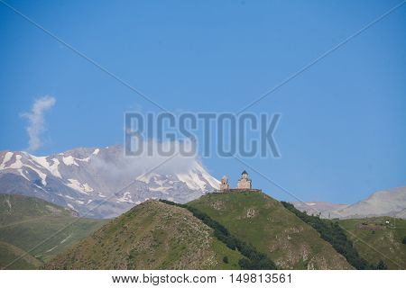 View if the Gergeti Trinity Church in the Caucasus mountains Georgia.