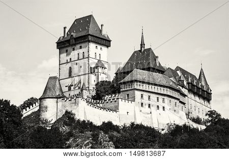Karlstejn is a large gothic castle founded 1348 by Charles IV in Czech republic. Black and white photo. Ancient architecture. Travel destination. Beautiful place.