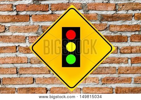 Traffic lights sign on brick wall or brown background