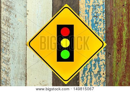Traffic lights sign on wood wall on wood background