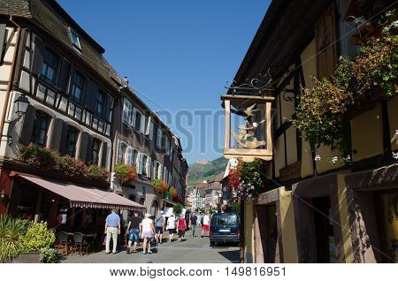 RIBEAUVILLE, FRANCE - SEPTEMBER 13:  The main street Grand Rue in the old village Ribeauville in Alsace in France located by the Alsace wine route on September 13, 2016.
