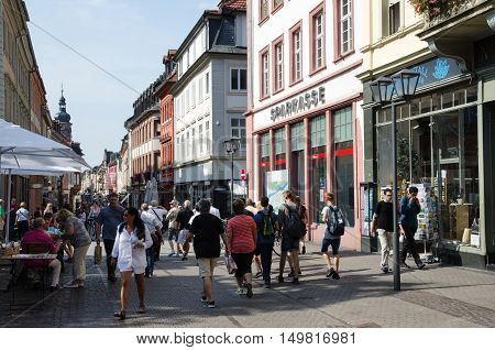 HEIDELBERG, GERMANY - SEPTEMBER 15: Tourists walking at the main street Haptstrasse in the old german city Heidelberg on September 15, 2016.