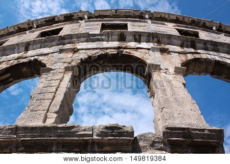 Stone Arches of Old Roman Colosseum i