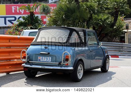 Monte-Carlo Monaco - May 18 2016: Blue Retro Car Austin Mini Cooper (Rear View) At The City Street in Monaco French Riviera