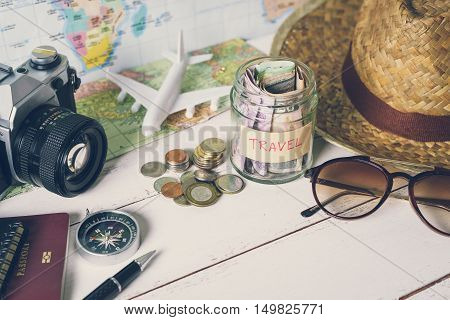 Collecting money for travel with accessories of traveler Travel concept
