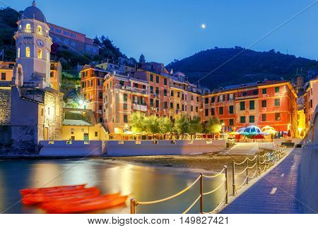The old main square on the waterfront in the Italian village of Vernazza at night. Parco Nazionale delle Cinque Terre, Liguria, Italy.