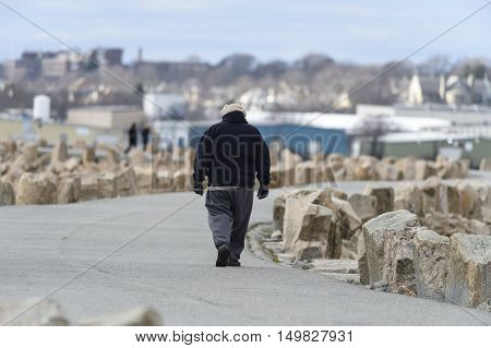 Fairhaven Massachusetts USA - January 1 2016: Dressed for a cold walk along the dike in Fairhaven Massachusetts on New Year's day