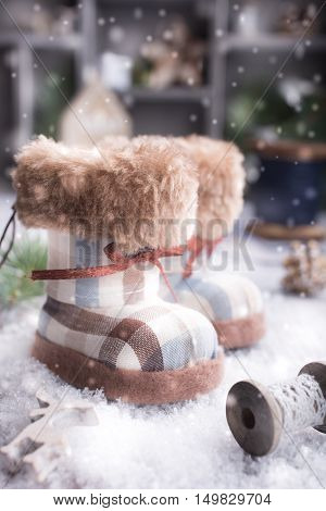 Christmas greeting card with felt boots, fir christmas tree, snow and decoration in vintage style. Christmas concept.