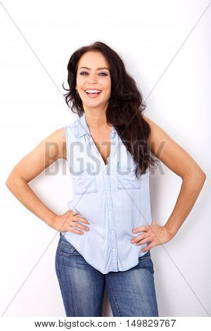 Confident Older Woman Smiling With Hands On Hips