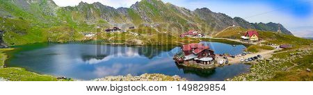 Panoramic view over Balea volcanic and natural lake of Fagaras mountain, Romania