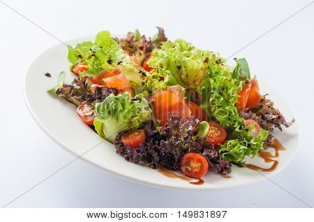 Modern style smoked salmon salad with balsamic dressing in ceramic dish