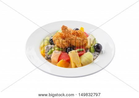 Front view of Modern cuisine style fruits salad with deep fried shrimp in ceramic dish isolated on white background