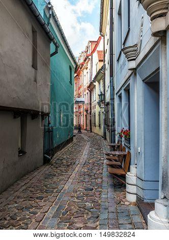 RIGA, LATVIA - OCTOBER 2016: Old medieval  stone narrow street in Riga, Latvia.