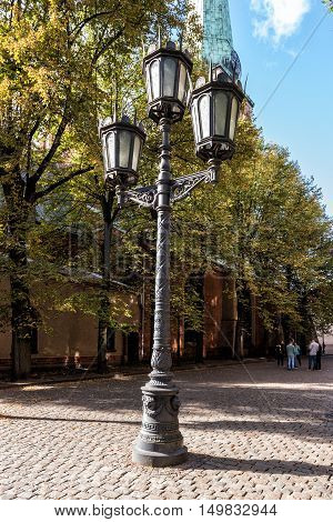 Vintage streetlight at street of old town in Riga, Latvia