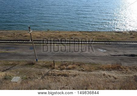 Section Of Circum-baikal Railway. Rail-track Running Near The Lake Baikal