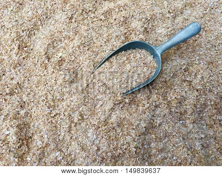 Wheat bran with a shovel made of metal