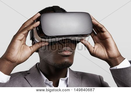 3D Technology, Virtual Reality, Entertainment, Cyberspace Concept. Young Dark-skinned Entrepreneur W