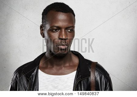 Human Face Expressions And Emotions. Studio Shot Of Young Attractive African Man Wearing Fashionable