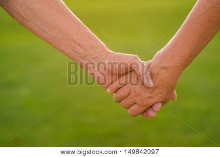 Hands of a senior couple. Two people holding hands. Devotion and trust. Together till the end.
