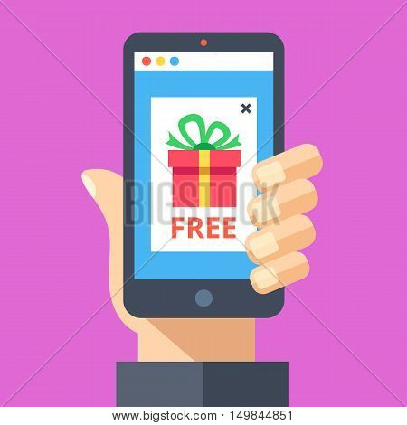 Hand holding smartphone with pop-up ad on screen with red gift and word free. Online advertising, sale, discount, promotion, internet fraud, scam concepts. Modern flat design vector illustration