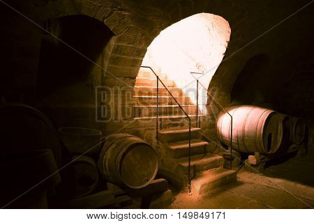 Wooden barrels in a wine cellar - German medieval wine cellar with round ceiling where are stored big wooden barrels