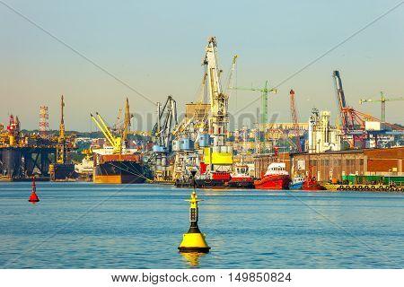 Cargo ship in the morning light on port of Gdansk Poland.
