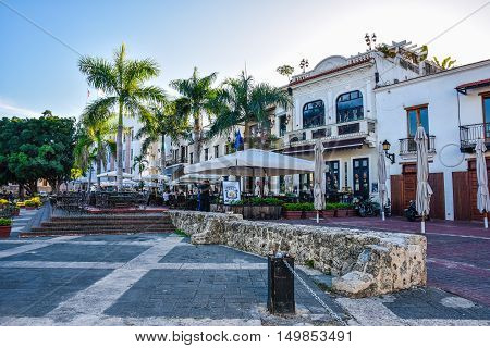 SANTO DOMINGO, DOMINICAN REPUBLIC - JANUARY 29, 2016: Famous place Las Atarazanas in Spanish Square with prestigious restaurants.