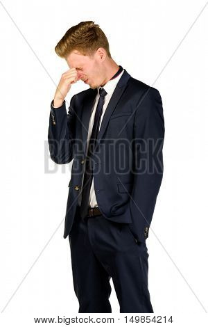 Young businessman in despair clutched his head. Crisis concept.
