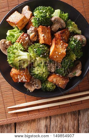 Fried Tofu Cheese With Broccoli, Mushrooms And Teriyaki Sauce Close-up. Vertical Top View