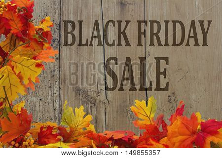 Black Friday Shopping Sale Autumn Leaves with grunge wood with text Black Friday Sale