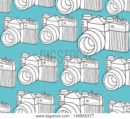 Seamless pattern with black and white photo cameras on the blue background. Vector illustration.