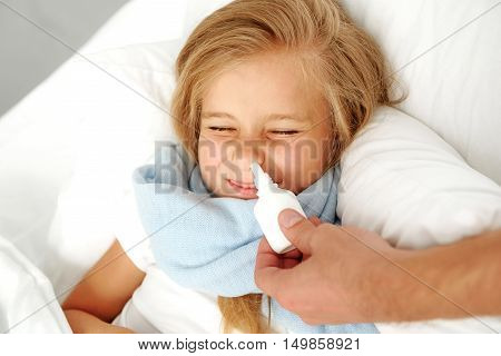 sickness and child care concept, girl lying in hospital