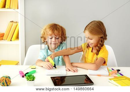 learning and next generation concept, modern preschoolers painting in front of digital tablet