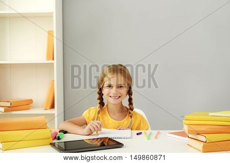 little girl at her workplace at home with copy space
