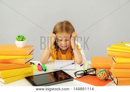 school and homework concept, girl cries of helpless