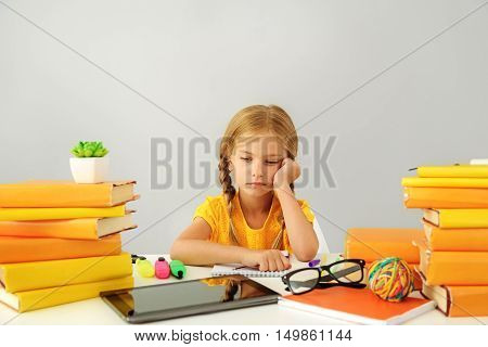 school and homework concept, girl sitting with books