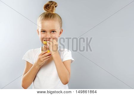 prophylaxis and health care concept, kid holding lemon with copyspace