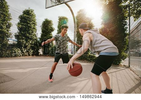 Young Friends Playing Basketball Together