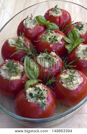 tomatoes filled with herbst an garlic in provencal style