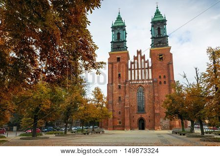 Poznan Poland - September 29 2016: View of entrance to The Archcathedral Basilica of St. Peter and St. Paull in polish city Poznan in Ostrow Tumski square. Place of burial of polish kings: Mieszko I and Boleslaw Chrobry.