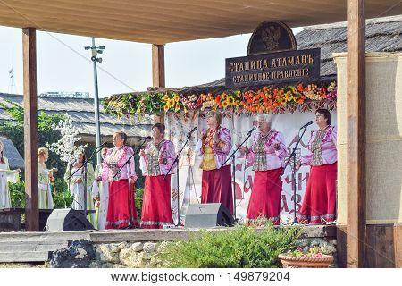 Folk Singer At A Concert In The Cossack Village Of Ataman. Folk Songs.