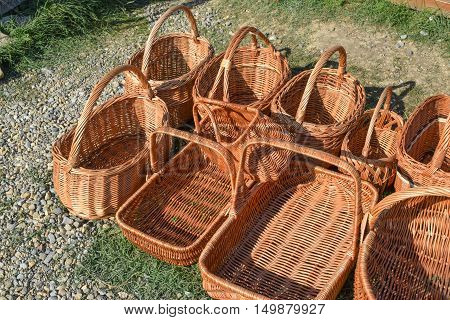 Several Wicker Baskets On The Ground
