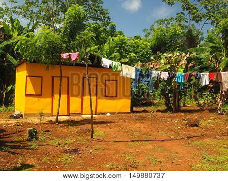 zinc sheet metal house in jungle with laundry drying Quinn Hill Big Corn Island Nicaragua Central America