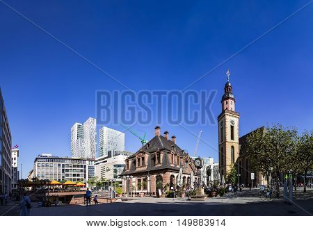 FRANKFURT GERMANY - SEP 29 2016: people enjoy the sunny day in Frankfurt Germany in cafe Hauptwache. The baroque building Hauptwache was built in 1730 as a police station and serves nowadays as a cafe.