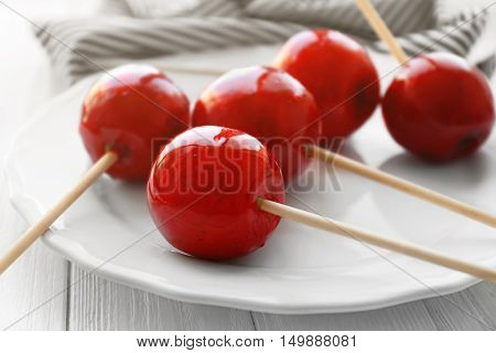 Toffee apples on white plate