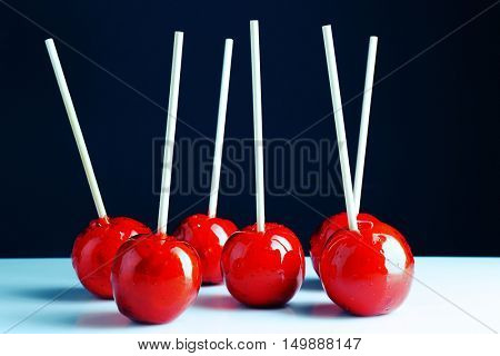 Toffee apples on white table