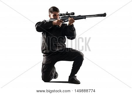 man in black military uniform aiming with rifle isolated on white background
