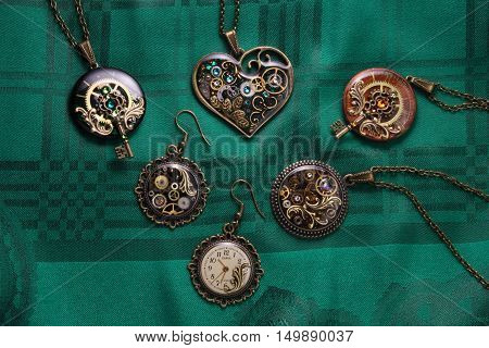 A collection of jewelry on green cloth background